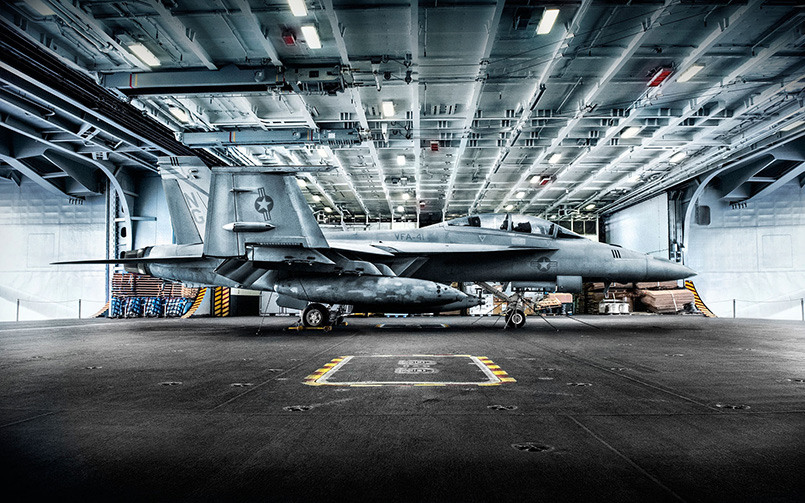 F18 Hornet fighter jet preparing to launch from an aircraft carrier.